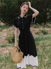 很仙的at式复古短袖ic夏季超仙法国(小)众赫本风过膝显瘦(小)黑裙