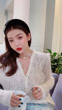 孙瑜儿ci仙的白色蕾ku羊毛衣女2021春秋新式宽松时尚针织开衫