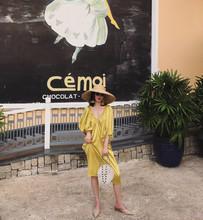 巴厘岛cu国度假chti松缎面V领露背长裙海边显瘦连衣裙金