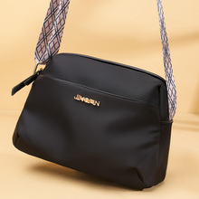 包包2di20新式潮de斜挎单肩包女士休闲时尚尼龙旅游(小)背包帆布