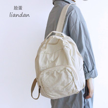 脸蛋1ko韩款森系文ta感书包做旧水洗帆布学生学院背包双肩包女