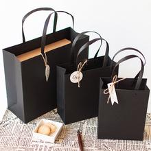 黑色礼ky袋送男友纸ru提铆钉礼品盒包装袋服装生日伴手七夕节
