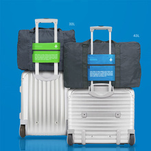 行李包ou手提轻便学lb行李箱上的装衣服行李袋拉杆短期旅行包