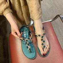 罗马凉pu女夏202sa百搭仙女风学生平底水钻的字夹脚趾沙滩女鞋