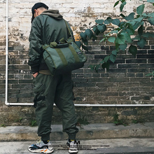 原创设qq纯色简约手ba容量多功能防水单肩旅行包厚帆布斜挎包