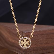 TORrj BURCzs骨链托里伯奇气质镶嵌钻石圆标圆形镂空TB项链女