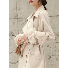 Spring new Korean version of the loose, short and handsome woman's coat with a long chic windbreaker over the waist and knee