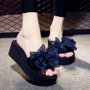 坡跟<span class=H>凉拖鞋</span>女夏2019时尚外穿欧美高跟水钻透明厚底一字拖性感百搭