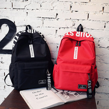 Baggage girl 2018 new double shoulder bag girl Korean version middle school students'schoolbag campus simple 100 Canvas Backpack letters