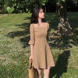 <span class=H>短裙</span>女装夏季韩版复?#27431;?#24335;少女显瘦高腰五分袖<span class=H>抹胸</span>方领格子连衣裙