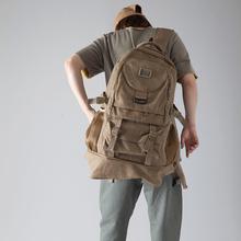 大容量ve肩包旅行包mo男士帆布背包女士轻便户外旅游运动包