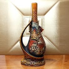 格鲁吉wo新式红葡萄iu瓶摆件红酒聚会礼品酒原瓶进口保真单支