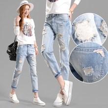 新式连x9韩款牛仔裤9w松浅色女式破洞裤潮流显瘦时尚卷边